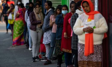 News - FILE PHOTO: Indian students and members of the Indian community queue for free food parcels at a local restaurant prepared by the Malayalee Association of the United Kingdom in the London borough of Newham on May 08, 2020 in London, England.  (Photo by Justin Setterfield/Getty Images)