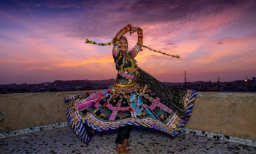 """FEATURES - In this picture taken on August 13, 2020, Kalbeliya gypsy dancer Aasha Sapera practices before hosting online dance classes amid the COVID-19 coronavirus pandemic in Jodhpur. - The coronavirus pandemic has forced many people to go online, but the largely nomadic, marginalised Kalbeliya face bigger challenges than most, with several living in mud huts or tents with patchy electricity and non-existent WiFi. """"In the beginning, I had no idea how to make this work,"""" dancer Aasha Sapera told AFP, describing her early forays into hosting classes on Zoom. (Photo by Sunil VERMA / AFP) / To go with AFP story 'INDIA-HEALTH-VIRUS-DANCE-COMMUNITIES-TRADITION-TECH' feature by Ammu Kannampilly and Sunil Verma (Photo by SUNIL VERMA/AFP via Getty Images)"""