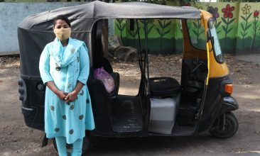 FEATURES - Talat Jahan, a domestic abuse survivor, poses for a photo next to her tuk-tuk in Bhopal India. Thomson Reuters Foundation/Handout by ActionAid