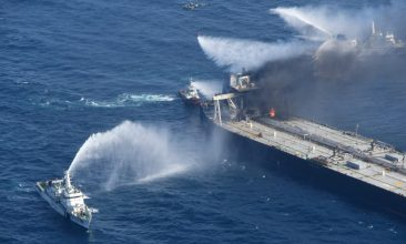 News - FILE PHOTO: A Sri Lankan Navy boat sprays water on the New Diamond, a very large crude carrier (VLCC) chartered by Indian Oil Corp (IOC), that was carrying the equivalent of about 2 million barrels of oil, after a fire broke out off the east coast of Sri Lanka, September 5, 2020. Sri Lankan Airforce media/Handout via REUTERS