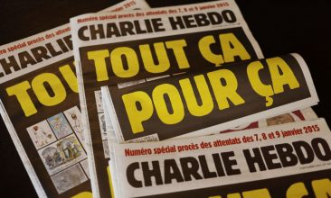 """News - FILE PHOTO: This picture taken on September 1, 2020 in Paris shows covers of French satirical weekly Charlie Hebdo reading """"All of this, just for that,"""" to be published on September 2 to mark this week's start of the trial for 14 accused in January 2015 jihadist attacks in Paris. (Photo by -/AFP via Getty Images)"""