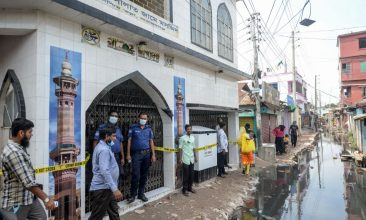 BANGLADESH - Police personnel stand guard in front of a mosque, following a fire accident, in Narayanganj on September 6, 2020. A suspected gas explosion in a mosque just outside the Bangladesh capital has killed 24 people with a dozen more fighting for their life with critical burn injuries, officials said. (Photo by MUNIR UZ ZAMAN/AFP via Getty Images)