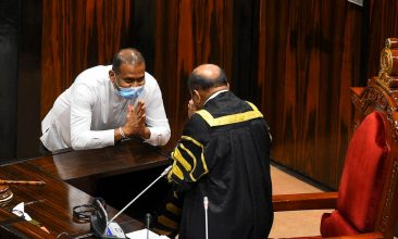 HEADLINE STORY - Sri Lanka's convicted murderer Premalal Jayasekara (L) gestures after sworn in as a member of parliament from the ruling party in front of Speaker of the Parliament of Sri Lanka Mahinda Yapa Abeywardena (R), in Colombo on September 8, 2020. Jayasekara becomes the first convict facing a death sentence to become a legislator in Sri Lanka. (Photo by ISHARA S. KODIKARA/AFP via Getty Images)