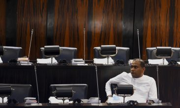News - Sri Lanka's convicted murderer Premalal Jayasekara sits after swearing-in as a member of parliament from the ruling party in Colombo on September 8, 2020. (Photo by ISHARA S. KODIKARA/AFP via Getty Images)