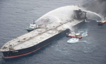 News - FILE PHOTO:  A Sri Lankan Navy boat sprays water on the New Diamond, a very large crude carrier (VLCC) chartered by Indian Oil Corp (IOC), that was carrying the equivalent of about 2 million barrels of oil, after a fire broke out off east coast of Sri Lanka September 8, 2020. Sri Lankan Airforce media/Handout via REUTERS