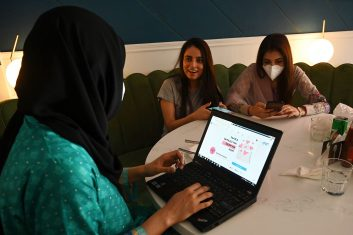 FEATURES - Women discuss as they check out the social online group 'The Soul Sisters Pakistan' on their Facebook page, in Lahore. (Photo by ARIF ALI/AFP via Getty Images)