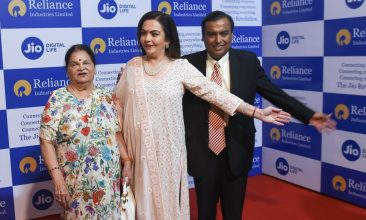 Business - FILE PHOTO: India's richest man and oil-to-telecom conglomerate Reliance Industries chairman Mukesh Ambani (R) along with his wife Nita Ambani (C) and mother Kokilaben (L) welcome guests as they arrive for the company's 42nd AGM in Mumbai on August 12, 2019. (Photo credit should read INDRANIL MUKHERJEE/AFP via Getty Images)