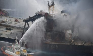 News - A Sri Lankan Navy boat sprays water on the New Diamond, a very large crude carrier (VLCC) chartered by Indian Oil Corp (IOC), that was carrying the equivalent of about 2 million barrels of oil, after a fire broke out off east coast of Sri Lanka September 8, 2020. Sri Lankan Airforce media/Handout via REUTERS