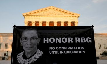 Comment - A banner with an image of the late US Supreme Court Justice Ruth Bader Ginsburg and a message referring to the selection of her successor is displayed outside the US Supreme Court in Washington, September 19, 2020 (REUTERS/Yuri Gripas).