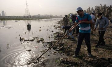 Business - FILE PHOTO: Indian volunteers clean the banks of the Yamuna River as they participate in Namami Gange, a government programme with the aim to clean and protect the Ganges and its affluents, in New Delhi on June 28, 2019. (NOEMI CASSANELLI/AFP via Getty Images)