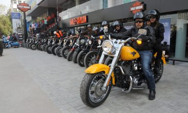 Business - Managing Director of Harley-Davidson India Anoop Prakash (R)  leads a bike rally from  Nine Bridges Harley-Davidson during the inauguration of Harley Davidson's dealership in Ahmedabad on November 27, 2011. Around 26 owners of Harley-Davidson's participated in a bike rally to mark the occasion. Harley, which received 25 percent of revenue outside the United States in 2006, forecasts 40 percent of sales from international markets by 2014. More than half of Harley's dealerships are outside the U.S. AFP PHOTO / Sam PANTHAKY (Photo credit should read SAM PANTHAKY/AFP via Getty Images)
