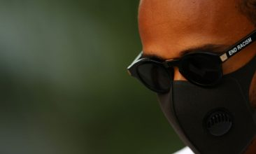 """MOTOR RACING - Lewis Hamilton of Great Britain and Mercedes GP walks in the paddock sporting """"End Racism"""" sunglasses during previews ahead of the F1 Grand Prix of Russia at Sochi Autodrom on September 24, 2020 in Sochi, Russia. (Photo: Mark Thompson/Getty Images)"""