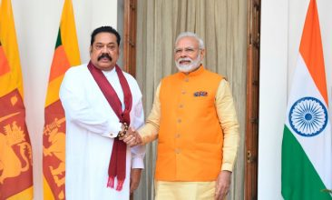 News - FILE PHOTO: India's Prime Minister Narendra Modi (R) shakes hands with Sri Lanka's Prime Minister Mahinda Rajapaksa prior to a meeting in New Delhi on February 8, 2020. - (Photo by PRAKASH SINGH/AFP via Getty Images)