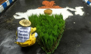 INDIA - A farmer of the Trinamool Congress (TMC) arranges crops as a shape of the map of India while participating in a protest against the Indian Prime Minister Narendra Modi's government during a nationwide farmers' strike following the recent passing of agriculture bills in the Lok Sabha (lower house), in  Kolkata on September 25, 2020. (Photo by DIBYANGSHU SARKAR/AFP via Getty Images)