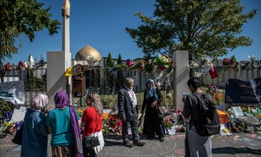 CRICKET - People pause next to flowers and tributes outside Al Noor mosque on March 24, 2019 in Christchurch, New Zealand. (Photo by Carl Court/Getty Images)