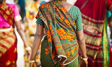 FEATURES - Indian Women dressed in colorful saris at the Taj Mahalhttp://refer.istockphoto.com/traffic_record.php?lc=056905042431004653&atid=6683%7CBannerID%3D6683%7CReferralMethod%3DLink