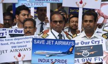 Business - India's Jet Airways employees hold placards during a silent protest in Mumbai on May 8, 2019. - India's debt-stricken Jet Airways halted all of its operations last month after failing to secure emergency funding from lenders, leaving it teetering on the edge of bankruptcy. (Photo by PUNIT PARANJPE / AFP)        (Photo credit should read PUNIT PARANJPE/AFP via Getty Images)