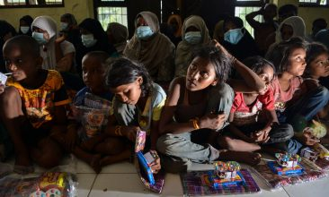 BANGLADESH - Rohingya people from Myanmar wait for aid at the immigration detention centre in Lhokseumawe in Indonesia's North Aceh Regency on June 26, 2020. - Nearly 100 Rohingya asylum seekers stranded off the coast of Indonesia were pulled to shore on June 25 by locals angered at the refusal of authorities to give them shelter over coronavirus fears. (Photo by CHAIDEER MAHYUDDIN / AFP) (Photo by CHAIDEER MAHYUDDIN/AFP via Getty Images)