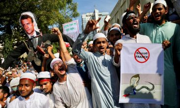 HEADLINE STORY - An effigy depicting the French president Emmanuel Macron is seen as Muslims chant slogans after Friday prayer during a protest calling for the boycott of French products and denouncing the French president Emmanuel Macron for his comments over Prophet Mohammed's caricatures, in Dhaka, Bangladesh, October 30, 2020. REUTERS/Mohammad Ponir Hossain