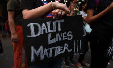 FEATURES - A demonstrator holds a placard reading 'Dalit Lives Matter' during a protest against the alleged gang-rape and murder of a 19-year-old woman in Uttar Pradesh state, in New Delhi on October 4, 2020. - India's federal investigators will take over the probe into the alleged gang-rape and murder of a low-caste teenaged woman that has sparked nationwide outrage and days of protests. (Photo by Sajjad HUSSAIN / AFP) (Photo by SAJJAD HUSSAIN/AFP via Getty Images)