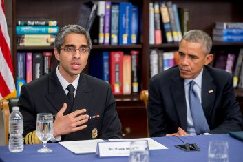 HEADLINE STORY - FILE PHOTO: Vivek Murthy, US surgeon general, left, speaks while participating in a roundtable discussion on the impacts of climate change on public health at Howard University with U.S. President Barack Obama in Washington, D.C., U.S., on Tuesday, April 7, 2015. (Photo by Andrew Harrer-Pool/Getty Images)