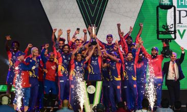CRICKET - Karachi Kings' cricketers celebrate with the trophy after winning the Pakistan Super League (PSL) Twenty20 cricket final match between the Karachi Kings and Lahore Qalandars at the National Stadium in Karachi on November 17, 2020. (Photo by Asif HASSAN / AFP) (Photo by ASIF HASSAN/AFP via Getty Images)