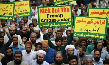 News - Supporters of hardline Islamist party Tehreek-e-Labbaik Pakistan carry placards and shout slogans during a protest against the reprinting cartoon of the Prophet Mohammad by French magazine Charlie Hebdo, in Rawalpindi on September 4, 2020. - Satirical weekly Charlie Hebdo, the target of a massacre by Islamist gunmen in 2015, reprinted the controversial caricatures this week to mark the start of the trial of the alleged accomplices in the attack. (Photo by Aamir QURESHI / AFP) (Photo by AAMIR QURESHI/AFP via Getty Images)