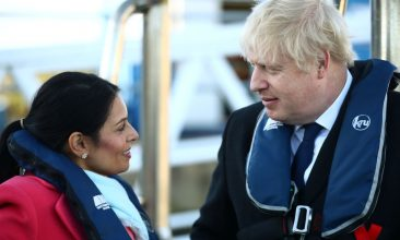 HEADLINE STORY - FILE PHOTO: Britain's Prime Minister Boris Johnson speaks with Home Secretary, Priti Patel aboard a security vessel at the Port of Southampton, Britain December 2, 2019.  (Photo by Hannah McKay - WPA Pool/Getty Images)