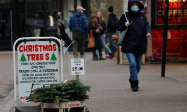 HEADLINE STORY - A sign selling Christmas trees is seen at the Cambridge Market Square, as the spread of the coronavirus disease (COVID-19) continues, in Cambridge, Britain November 20, 2020. REUTERS/Andrew Couldridge
