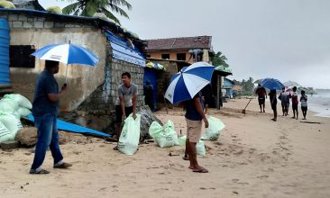 News - Residents prepare sand bags to protect their homes ahead of cyclone Burevi landfall in Sri Lanka's north-eastern coast, in Trincomalee on December 2, 2020. (Photo by STR/AFP via Getty Images)