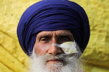 FEATURES - Santokh Singh, 70, a farmer who was hurt by a tear gas shell and received stitches, poses for a picture at the site of a protest against the newly passed farm bills, at Singhu border near Delhi, India December 2, 2020. REUTERS/Anushree Fadnavis