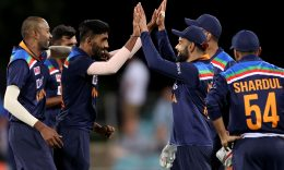 CRICKET - India's captain Virat Kohli (2nd R) congratulates paceman Jasprit Bumrah (2nd L) for his wicket of Shardul Thakur during the third one-day international cricket match between Australia and India at Manuka Oval in Canberra on December 2, 2020. (Photo by DAVID GRAY / AFP) / / IMAGE RESTRICTED TO EDITORIAL USE - STRICTLY NO COMMERCIAL USE (Photo by DAVID GRAY/AFP via Getty Images)
