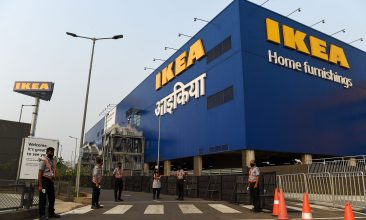 Business - Security personnel stand guard at the entrance of new IKEA store in Navi Mumbai on December 17, 2020. (Photo by PUNIT PARANJPE/AFP via Getty Images)