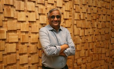 Business - FILE PHOTO: Kishore Biyani, CEO and founder of India's Future Group poses after the inauguration of Foodhall, a premium lifestyle food superstore by the Future Group, store in Mumbai, India, December 1, 2018. REUTERS/Francis Mascarenhas/File Photo