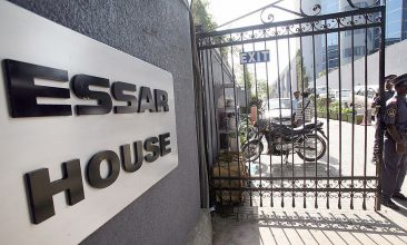 Business - FILE PHOTO: A security guard stands at the entrance to the headquarters of the Essar group in Mumbai, 05 January 2007. (INDRANIL MUKHERJEE/AFP via Getty Images)