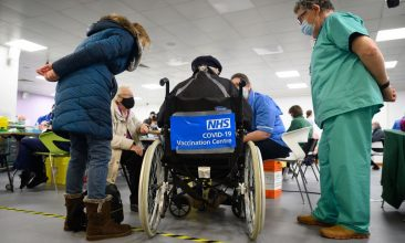 Coronavirus - A man waits in a wheelchair for his Covid-19 vaccination at the NHS vaccination centre in Robertson House in Stevenage, north of London on January 14, 2021 (Photo by LEON NEAL/POOL/AFP via Getty Images)