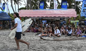 News - Spectators watch a surfing competition organised to revive local tourism with national and international participants present on the island at Arugam Bay in the east of Sri Lanka on September 27, 2020. (Photo by ISHARA S. KODIKARA / AFP) (Photo by ISHARA S. KODIKARA/AFP via Getty Images)