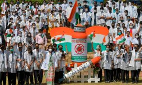 INDIA - Students and staff of a medical college take part in an awareness campaign for the Covid-19 coronavirus vaccination on the eve of Indias Republic Day in Bangalore on January 25, 2021. (Photo by MANJUNATH KIRAN/AFP via Getty Images)