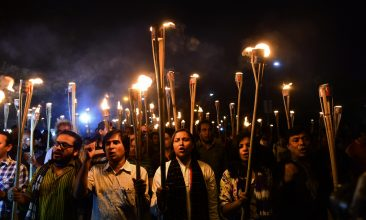 BANGLADESH - Bangladeshi activists take part in a torch-lit protest in Dhaka on November 2, 2015 against the killing of secular publisher Faisal Arefin Dipan.  (Photo credit should read MUNIR UZ ZAMAN/AFP via Getty Images)