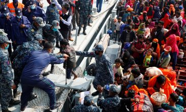 BANGLADESH - FILE PHOTO: Bangladesh Navy personnel help a disabled Rohingya refugee child to get off from a navy vessel as they arrive at the Bhasan Char island in Noakhali district, Bangladesh, December 29, 2020. REUTERS/Mohammad Ponir Hossain/File Photo