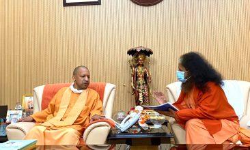 INDIA - His Holiness Pujya Swami Chidanand Saraswatiji (R) with Uttar Pradesh chief minister Yogi Adityanath