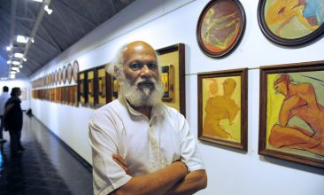 INDIA - Indian artist Jatin Das poses at an exhibition of works of art at The Ahmedabad-Ni-Gufa Gallery in Ahmedabad on April 13, 2011. Das is one of India's most prolific figurative painters. The exhibition which began on April 12 will conclude on April 24. AFP PHOTO/Sam PANTHAKY (Photo credit should read SAM PANTHAKY/AFP via Getty Images)