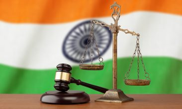 INDIA - India flag and golden scale with a judge's gave