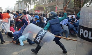BANGLADESH - Policemen clash with the activists of Bangladesh Nationalist Party (BNP) during the third  day of protests following the death of Mushtaq Ahmed, a prominent writer and government  critic in jail, in front of the National Press Club in Dhaka on February 28, 2021.  (Photo by SONY RAMANY/AFP via Getty Images)