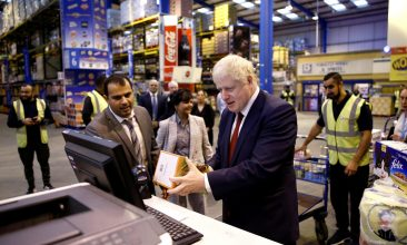 Business - Britain's Prime Minister Boris Johnson scans an item during a visit to Bestway Wholesale on September 30, 2019 in Manchester, United Kingdom.  (Photo by Henry Nicholls - WPA Pool / Getty Images)