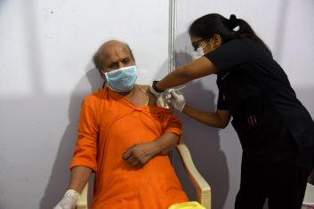 Coronavirus - A health worker inoculates a man with a dose of the Covishield, AstraZeneca-Oxford's Covid-19 coronavirus vaccine at a vaccination centre during a weekend lockdown imposed by the state government amidst rising Covid-19 coronavirus cases, in Mumbai on April 10, 2021. (Photo by Sujit Jaiswal / AFP) (Photo by SUJIT JAISWAL/AFP via Getty Images)