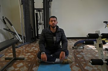 FEATURES - In this picture taken on March 26, 2021, Hassan Ali Kasi, a qari or professional reciter of the Koran, practices yoga as part of his training regime in Islamabad. - To master the art of Koran recitation, 21-year-old Kasi had to follow a strict regime of yoga, hours of rehearsing vocal scales -- and a total ban on biryani. - TO GO WITH Pakistan-Culture-Religion-Islam-Qari (Photo by Aamir QURESHI / AFP) / TO GO WITH Pakistan-Culture-Religion-Islam-Qari (Photo by AAMIR QURESHI/AFP via Getty Images)