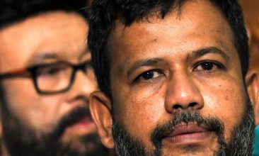 HEADLINE STORY - FILE PHOTO: Sri Lanka's Muslim cabinet member Rishad Bathiudeen (R) takes part in a press conference in Colombo on June 3, 2019, after his resignation. (LAKRUWAN WANNIARACHCHI/AFP via Getty Images)