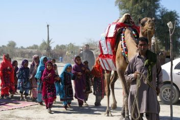 FEATURES - Children react as a camel carries books in Mand, Pakistan April 11, 2021. Fuzul Bashir/via REUTERS ATTENTION EDITORS - THIS IMAGE HAS BEEN SUPPLIED BY A THIRD PARTY. NO RESALES. NO ARCHIVES.