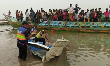 BANGLADESH - Policemen inspect a speed boat that was carrying passengers when it collided with a vessel transporting sand killing at least 26 people, in Madaripur on May 3, 2021. (Photo by - / AFP)